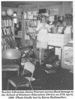 Teacher Librarian Janice Pearson surveys flood damage to the School of Distance Education library on 27th April, 1990
